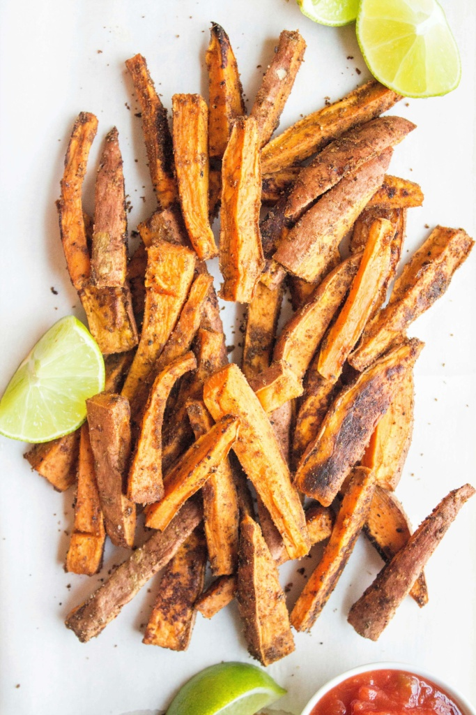 seasoned sweet potato fries with lime wedges