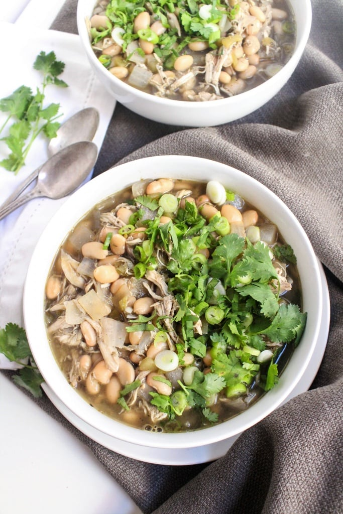 This Chicken White Bean Chili Soup is easy and so flavorful. Using rotisserie chicken is a great shortcut for weeknight dinners & makes this recipe super quick!