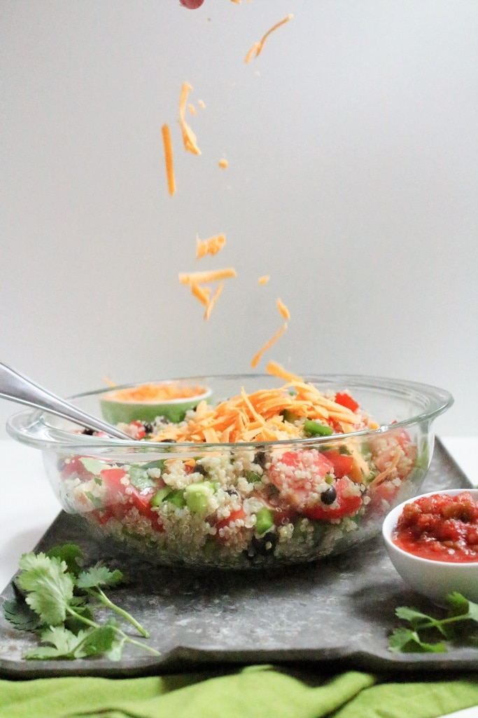 quinoa salad with cheese and salsa in a bowl