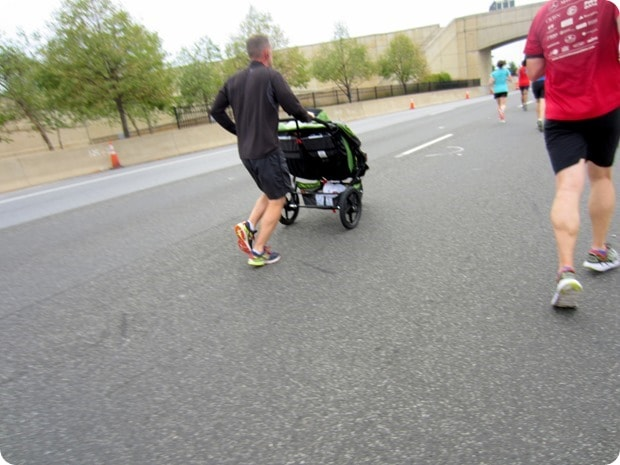 guy racing with a stroller