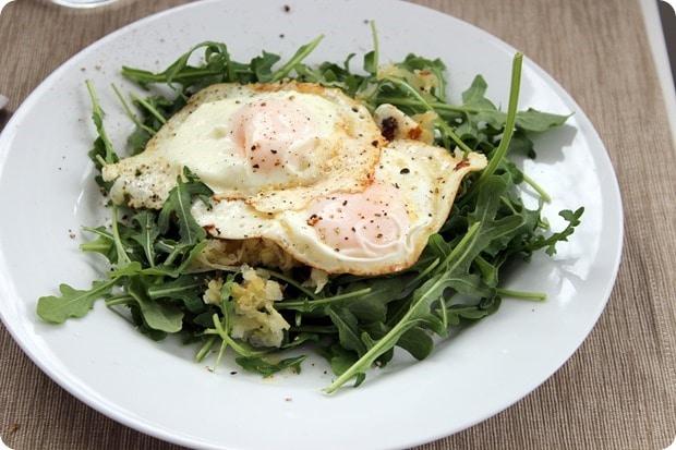 fried eggs arugula sauerkraut