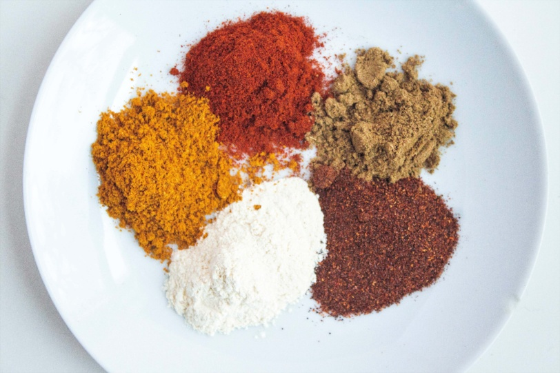 A bowl of various spices as pantry staples for flavoring food