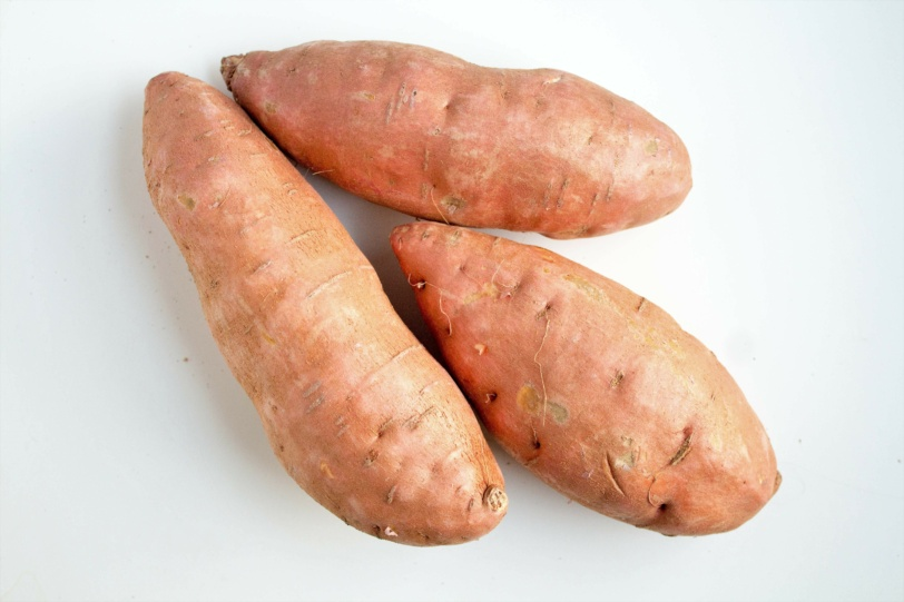 pantry staples: pile of sweet potatoes