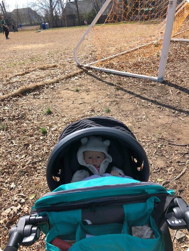 baby stroller at soccer field