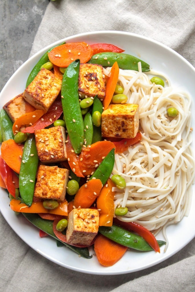 Tofu Stir Fry with Sriracha and Veggies - from @fannetasticfood's Mix & Match Stir Fry Recipes: Choose your favorite protein, veggies, and sauce for a delicious one-pan 15-minute dinner! The stir fry combinations are endless! #stirfry #healthydinner #onepotmeal #healthyrecipes