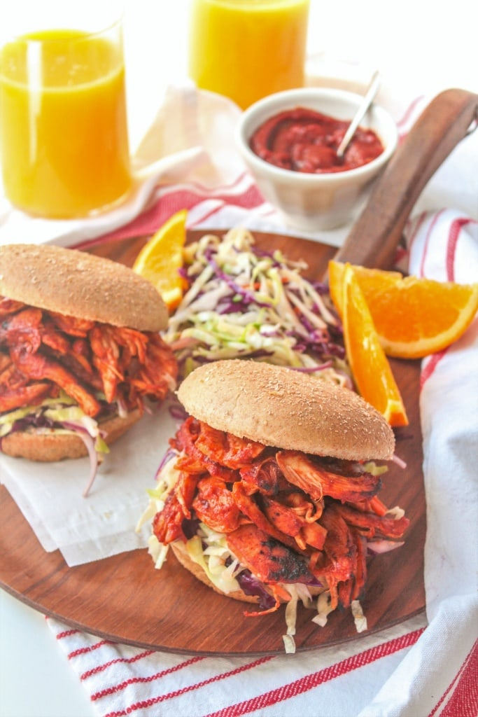 These Orange Juice BBQ Chicken Sandwiches are perfect for your next summer cookout -- the Florida Orange Juice BBQ sauce is tangy and flavorful without loads of added sugar!