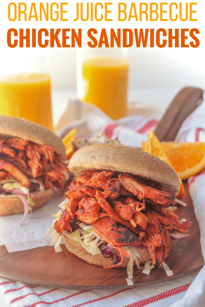 orange juice barbecue chicken sandwiches on a wooden platter: healthy grilling recipe for summer
