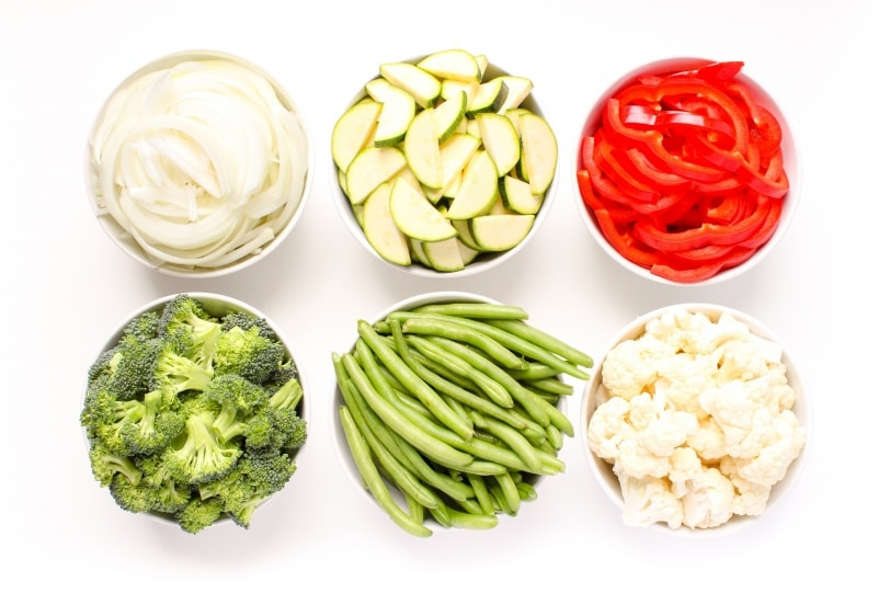 raw vegetables in small bowls