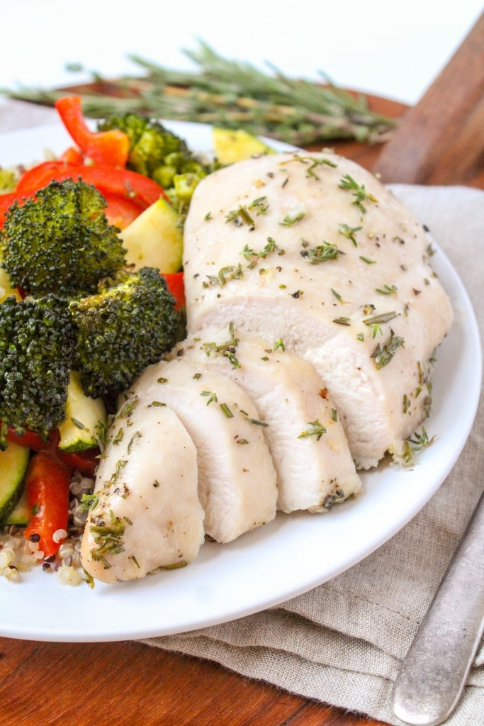garlic herb chicken breast and roasted vegetables on a plate