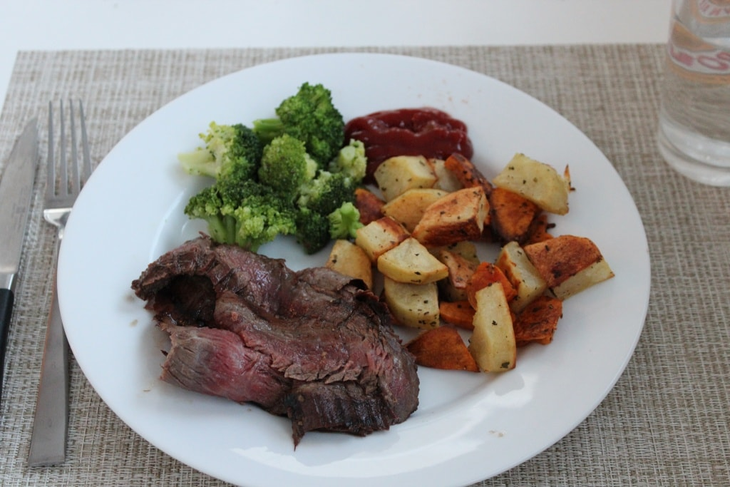 marinated flank steak with potatoes and broccoli