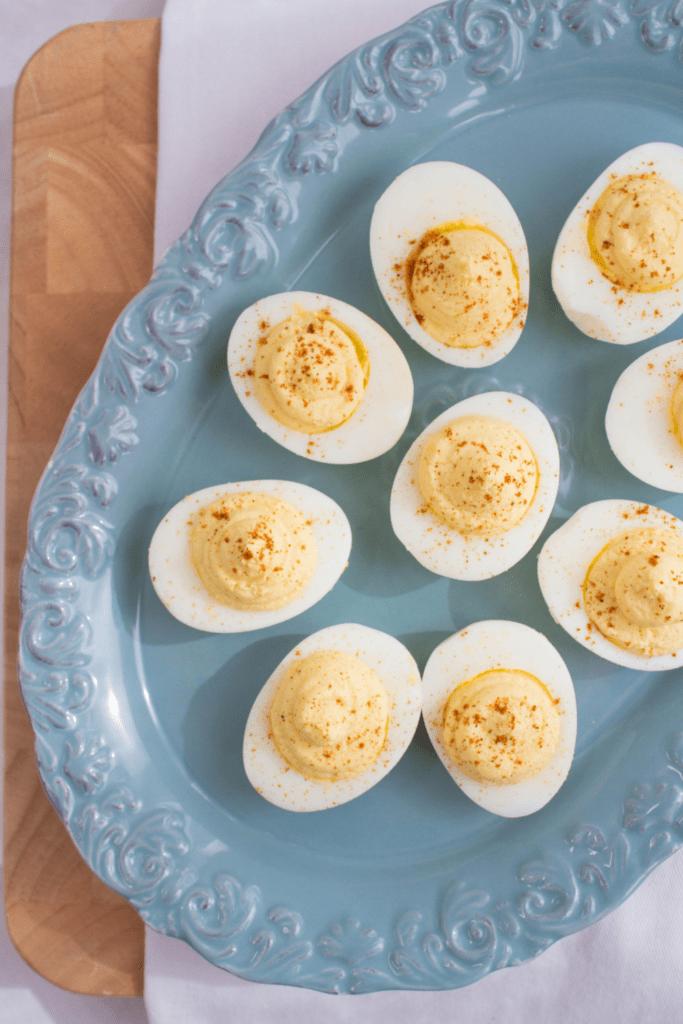 deviled eggs on a blue platter