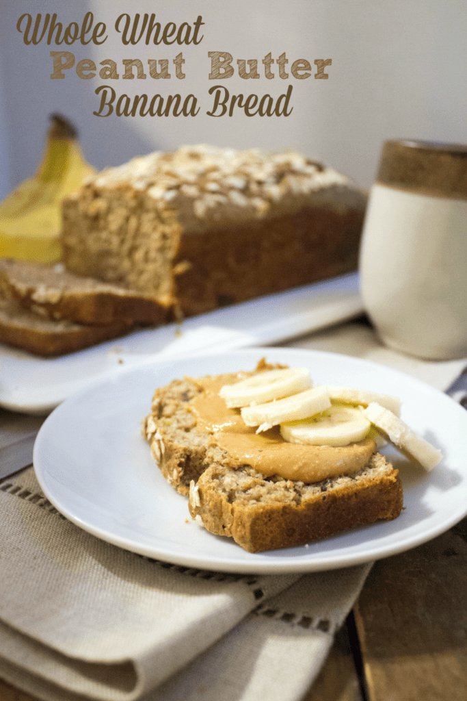 slice of healthy peanut butter banana bread on a plate with sliced banana on top