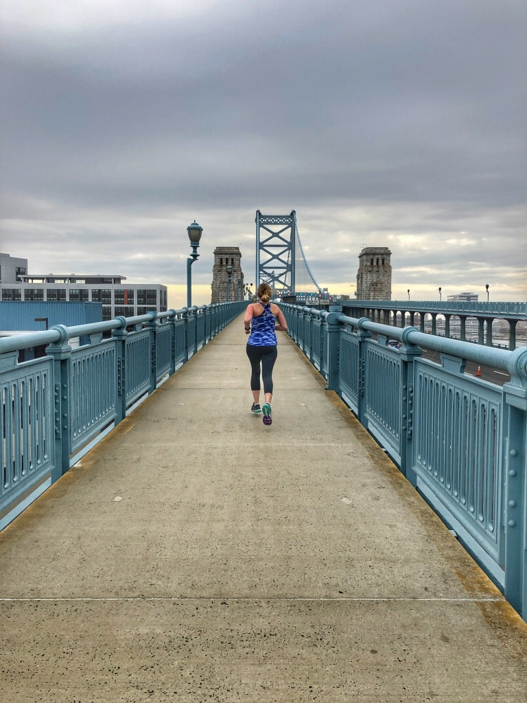 running the benjamin franklin bridge in philadelphia