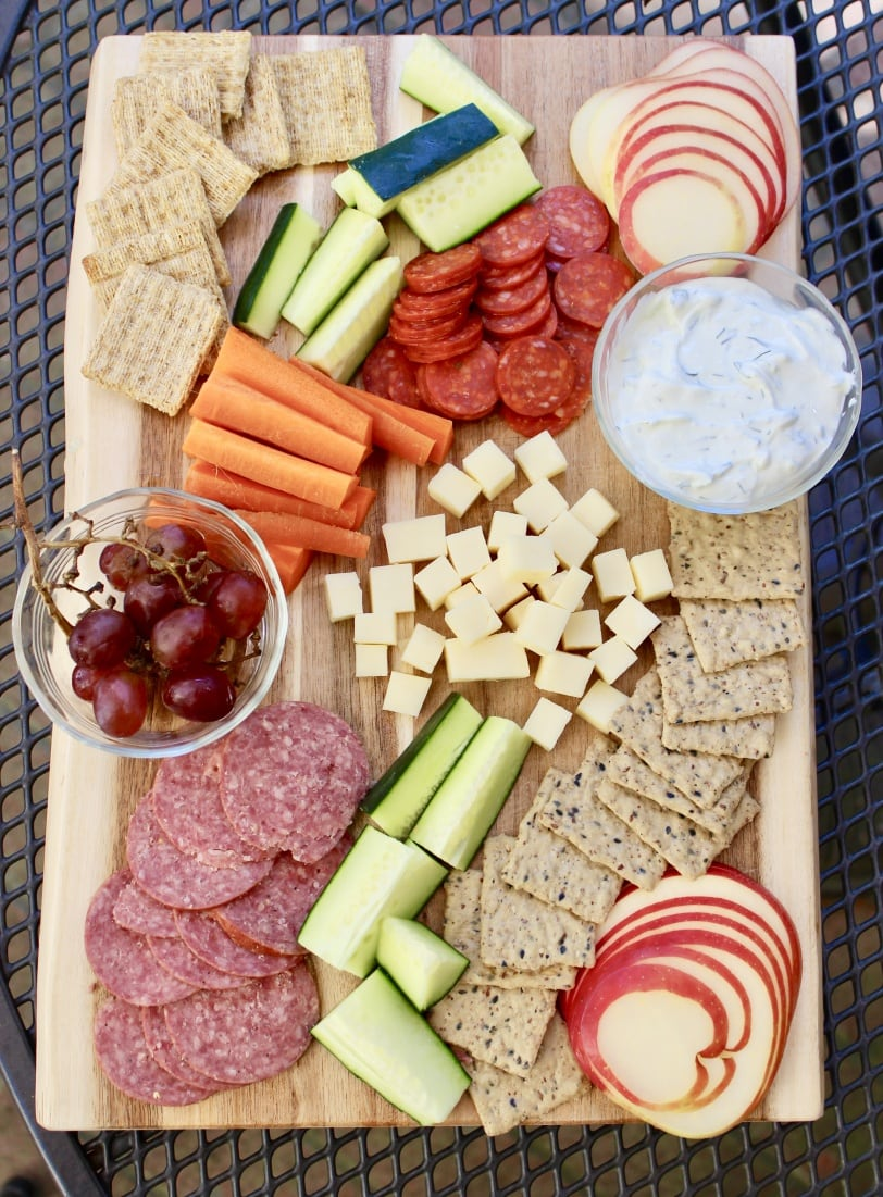 appetizer spread with cured meat cheese veggies crackers fruit