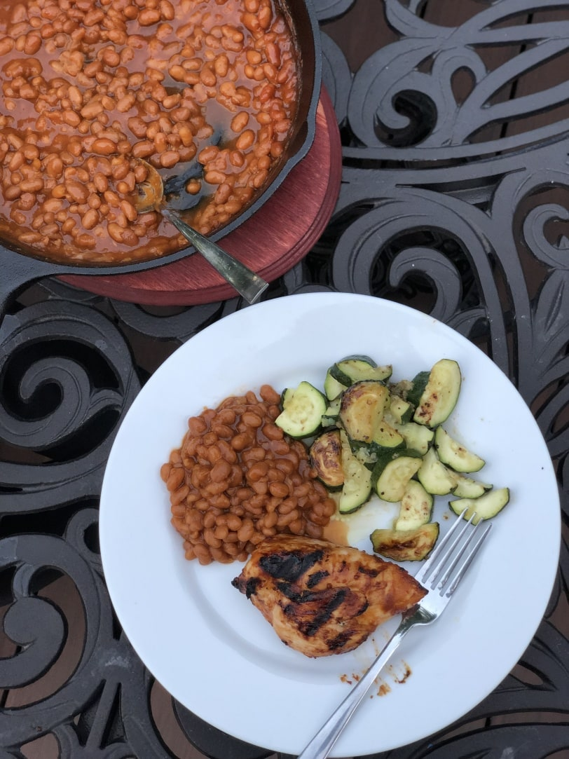 chicken and baked beans on grill