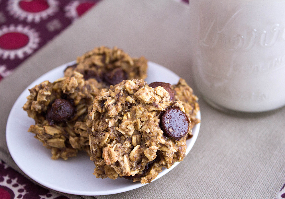 plate of oatmeal chocolate chip cookies with milk