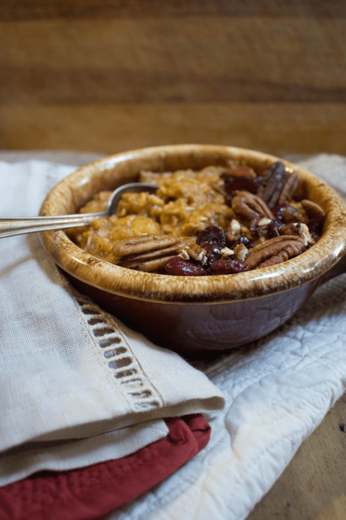 healthy pumpkin pie oatmeal with pecans and dried cranberries