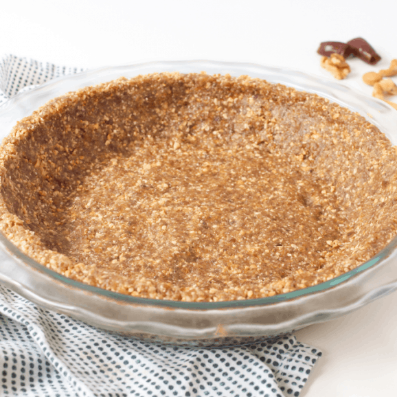 vegan pie crust in a glass dish