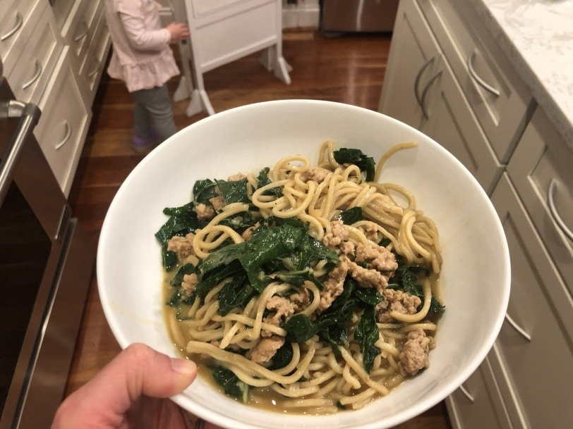 delicious noodle pork asian dish with kale