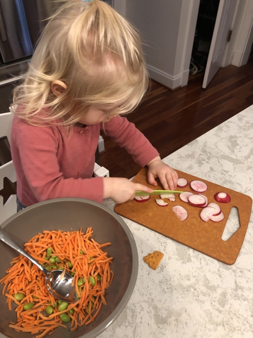 toddler slicing veggies