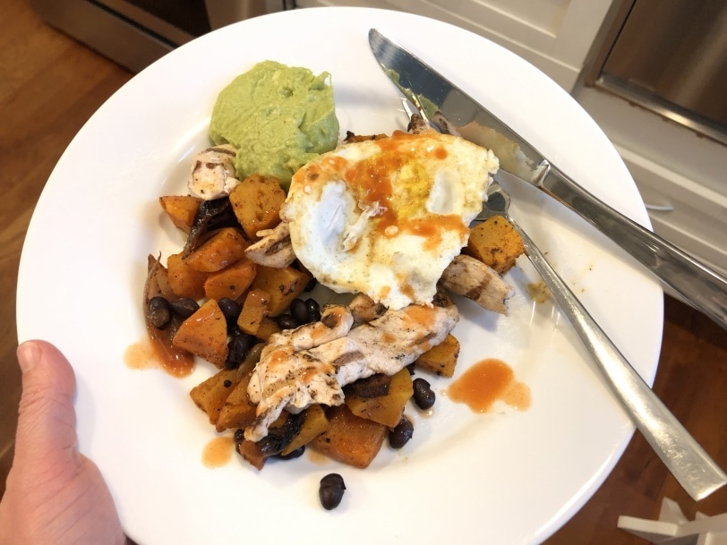 squash hash with black beans avocado chicken and fried eggs