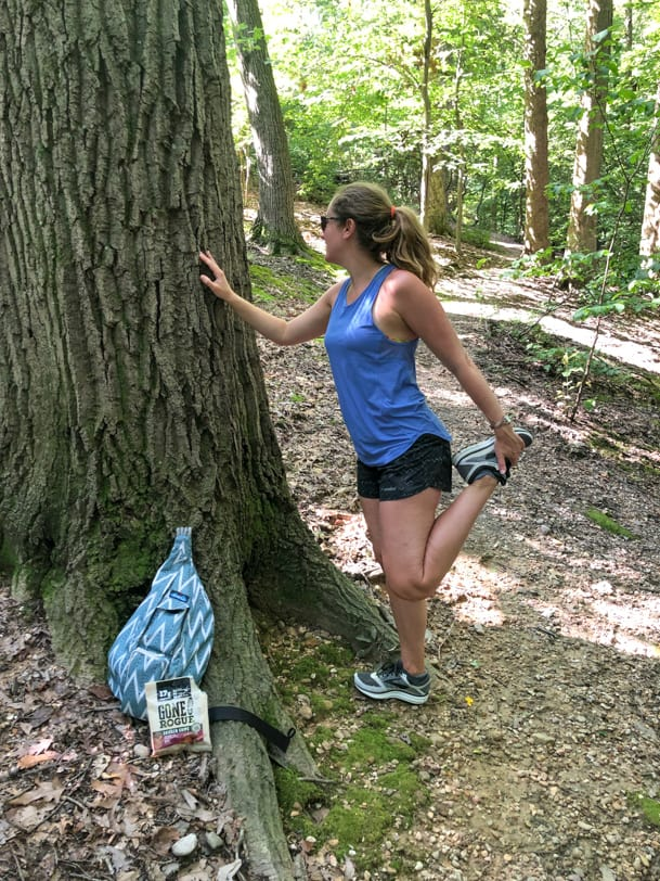 stretching on a tree on a hike