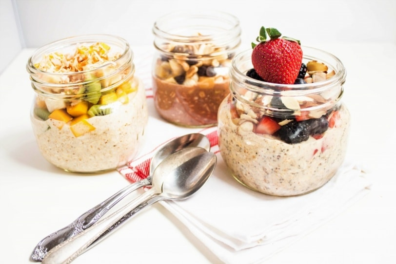 healthy overnight oats in jars with fruit and toppings