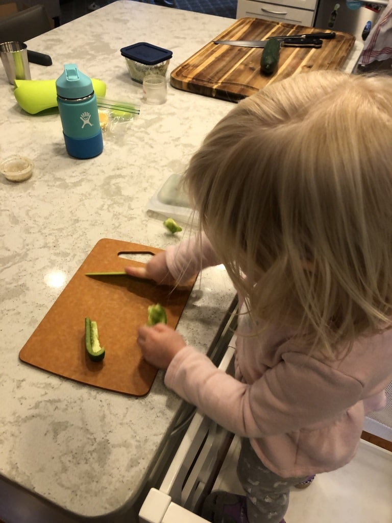 toddler helping in the kitchen