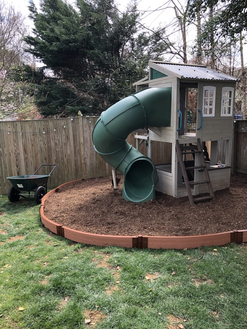 border around outdoor playhouse for kids