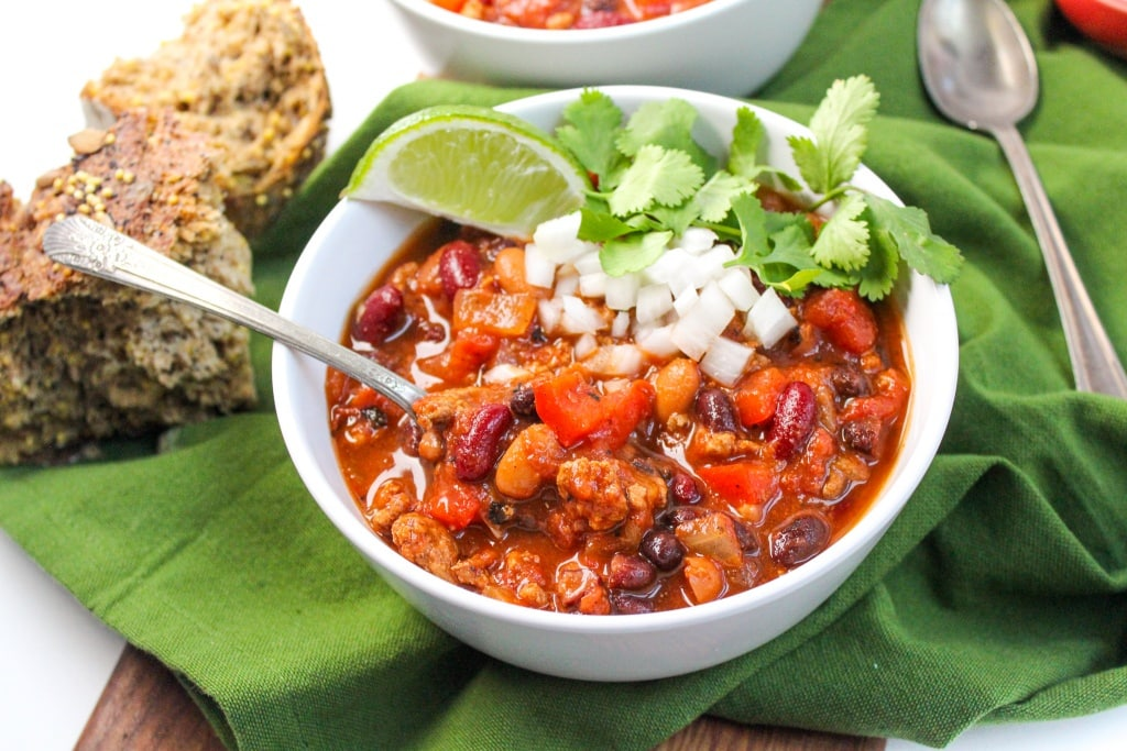 healthy slow cooker turkey chili with lime, onions, cilantro