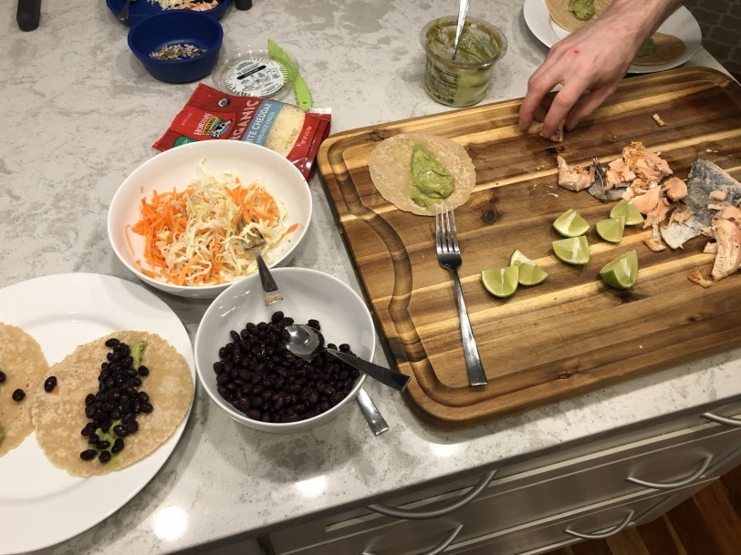 making salmon tacos for dinner