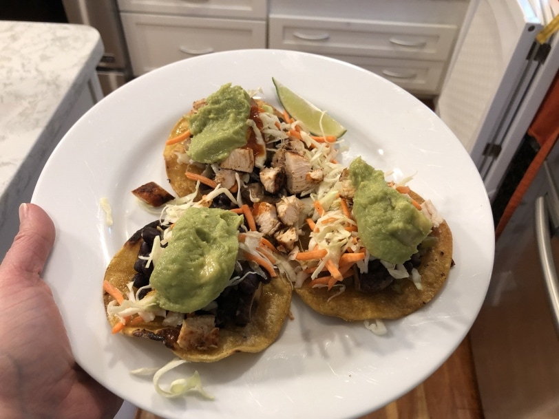 black bean and chicken tostadas with slaw and guacamole