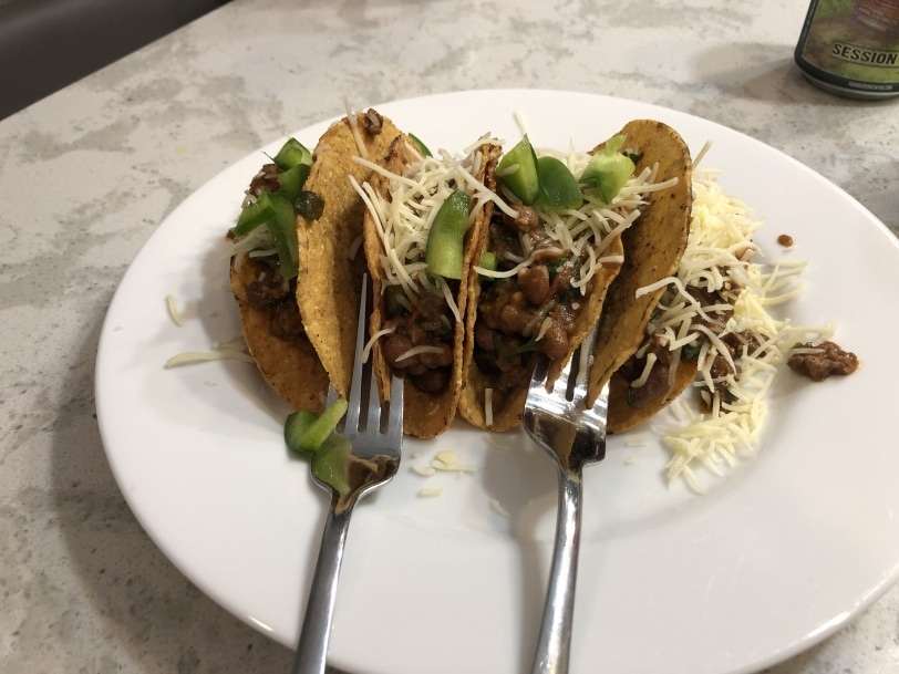 homemade tacos held up by forks