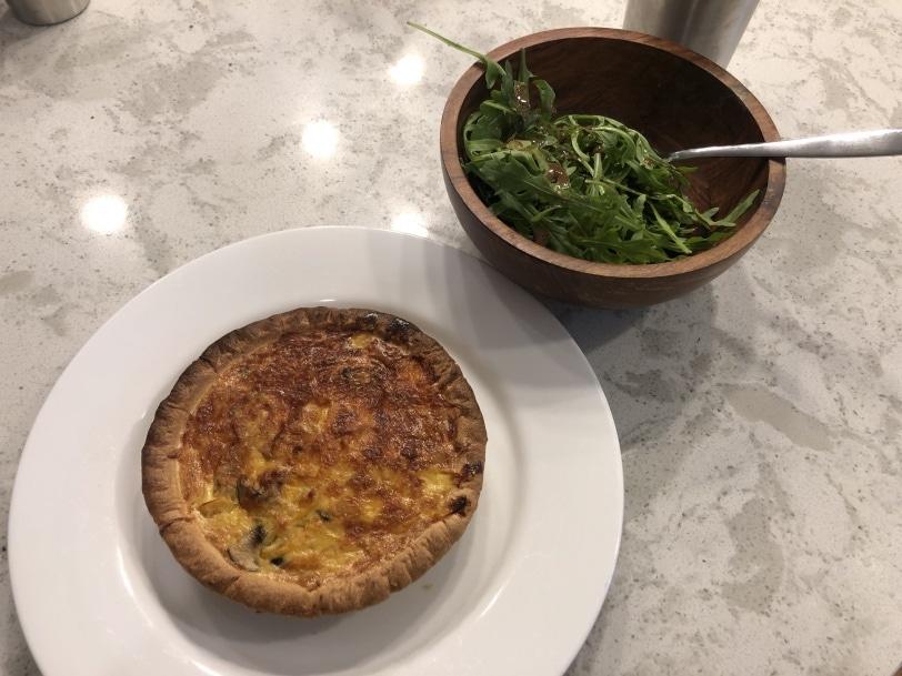 yellow pepper and mushroom quiche with arugula