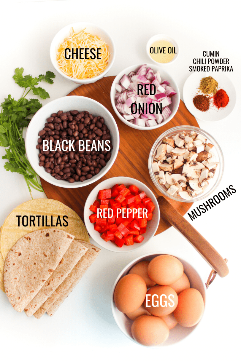 ingredients for healthy breakfast tacos recipe: eggs, black beans, mushrooms, bell peppers, etc.