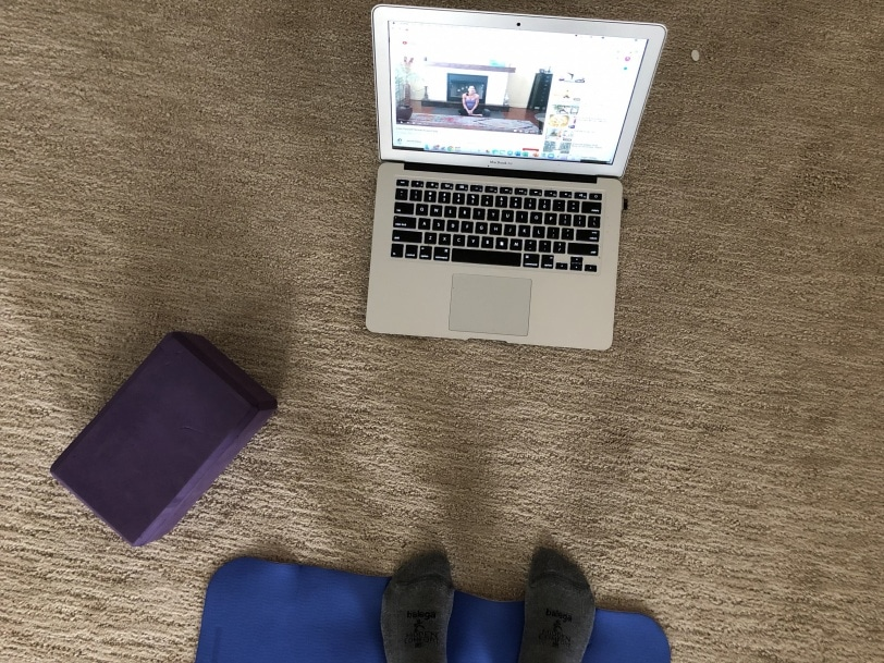 doing yoga at home via youtube video
