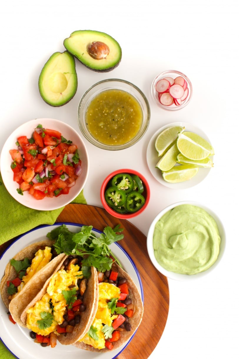 breakfast taco toppings: salsa verde, pico de gallo, and avocado crema