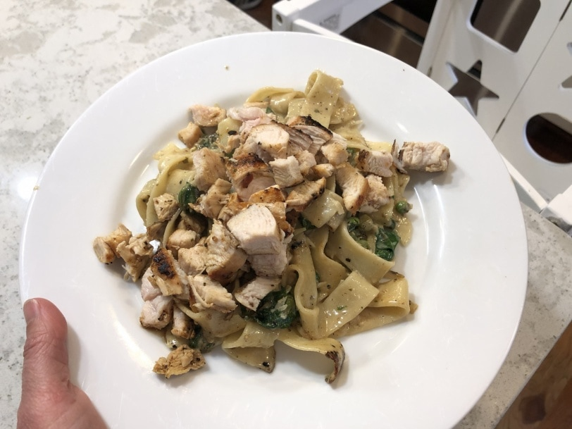 Pappardelle with wilted spinach, sweet peas, and fresh ricotta and chicken