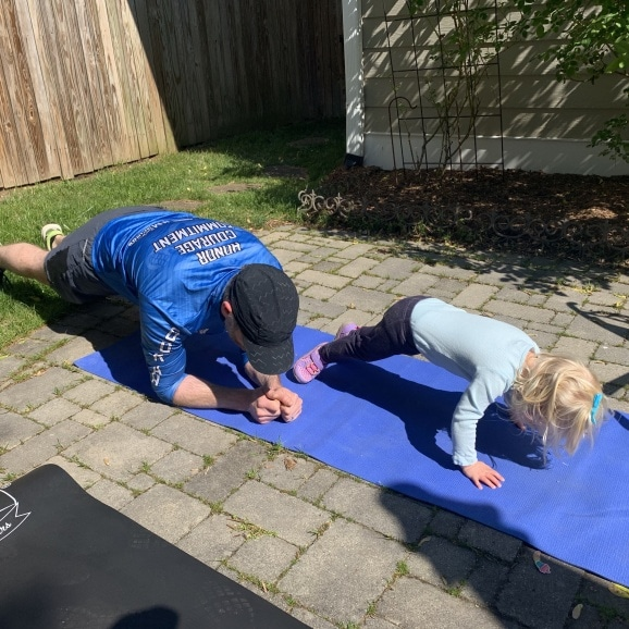 toddler exercising with dad