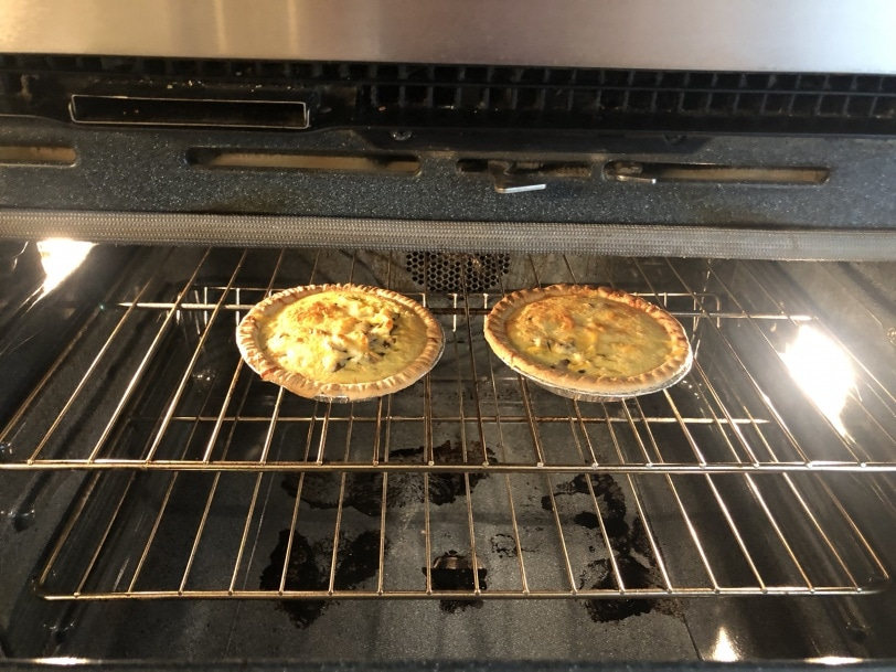 quiches cooking in oven