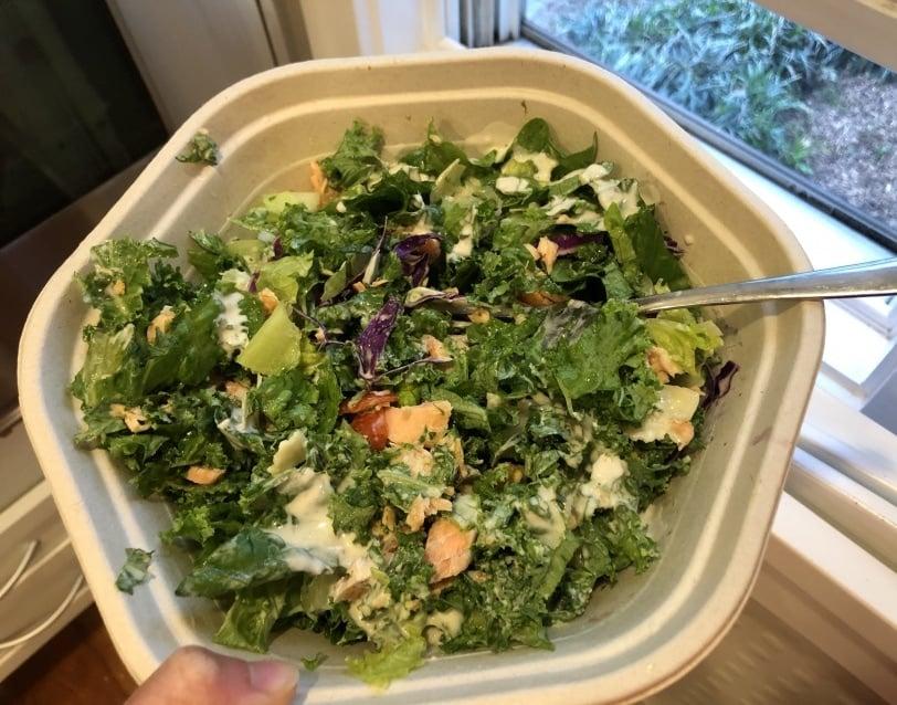kale caesar salad with salmon