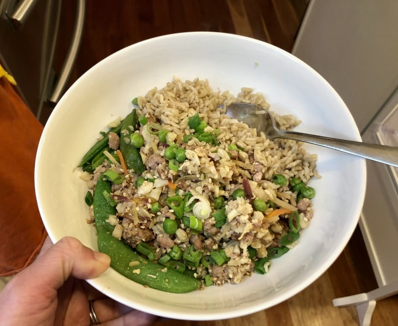 pork with cauliflower rice and peas
