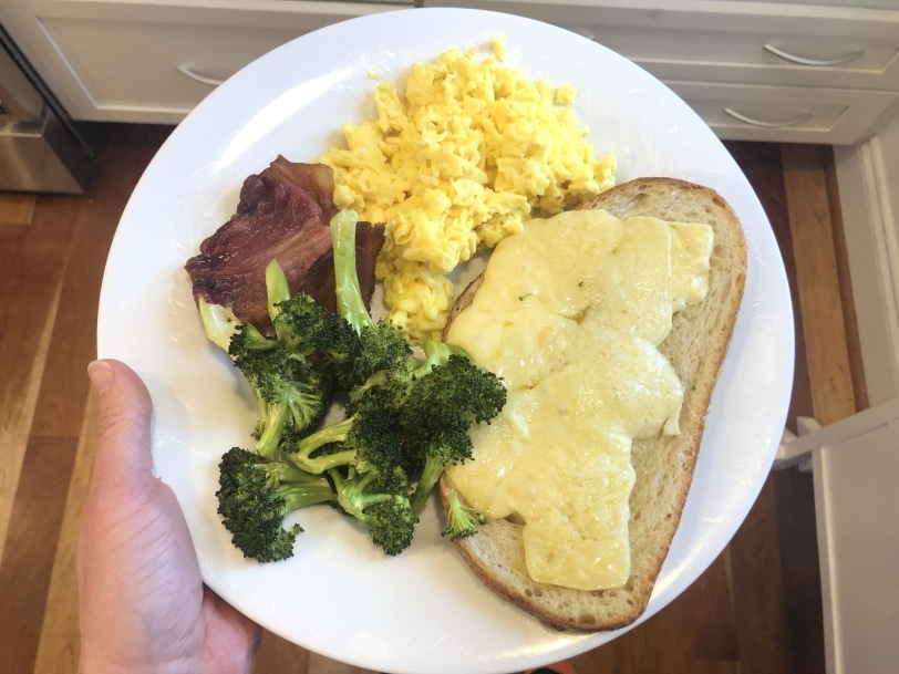 cheese toast with scrambled eggs roasted broccoli and bacon