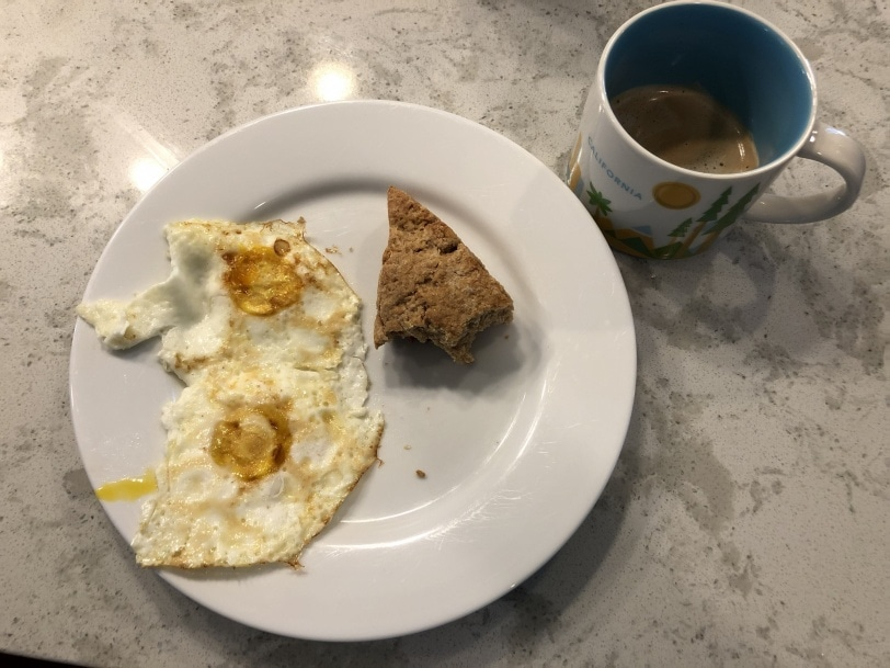 leftover strawberry scone with two fried eggs