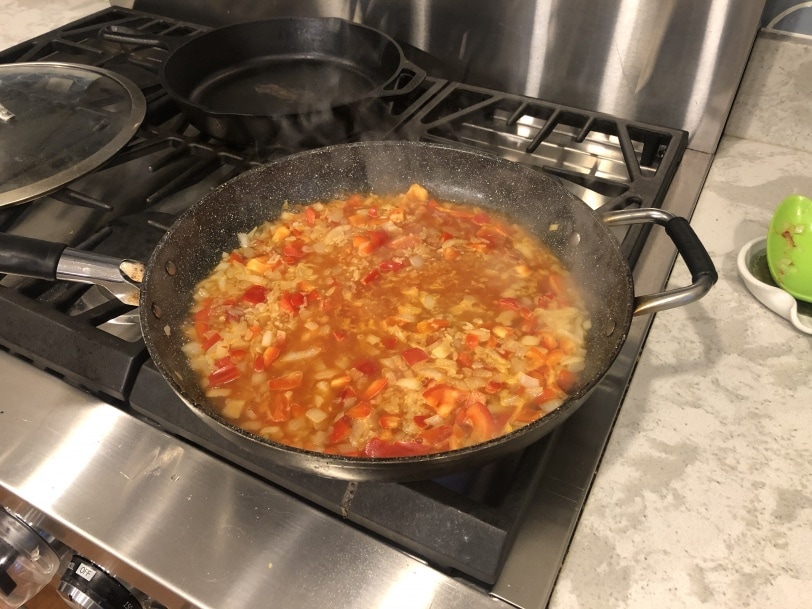 onion and red pepper simmering in pan