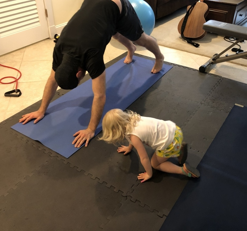toddler and dad doing planks