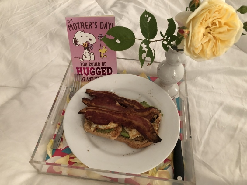 breakfast in bed - avocado toast with bacon and eggs