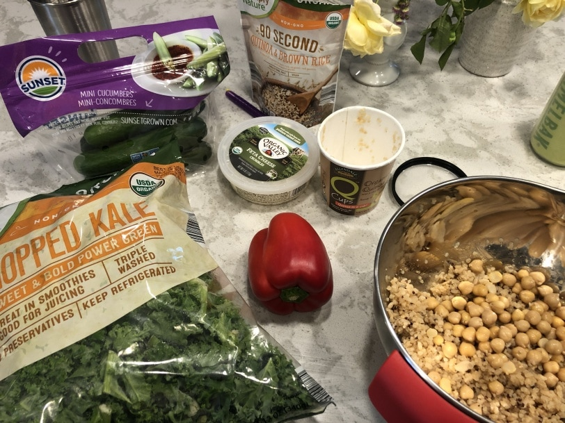 ingredients laid out to make a mediterranean quinoa salad