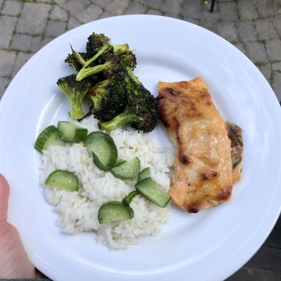 Asian salmon with pickled cucumber, roasted broccoli, and rice