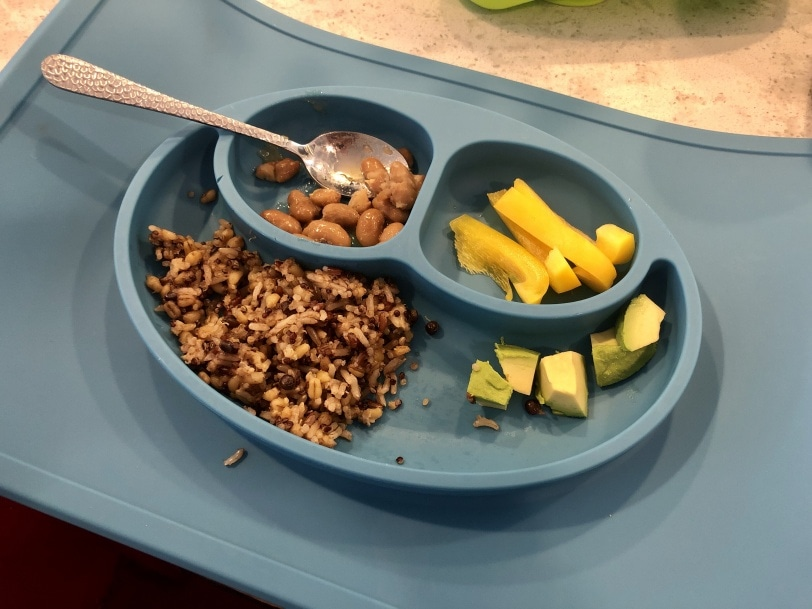 toddler meal of rice, quinoa, beans, yellow bell peppers, and avocado